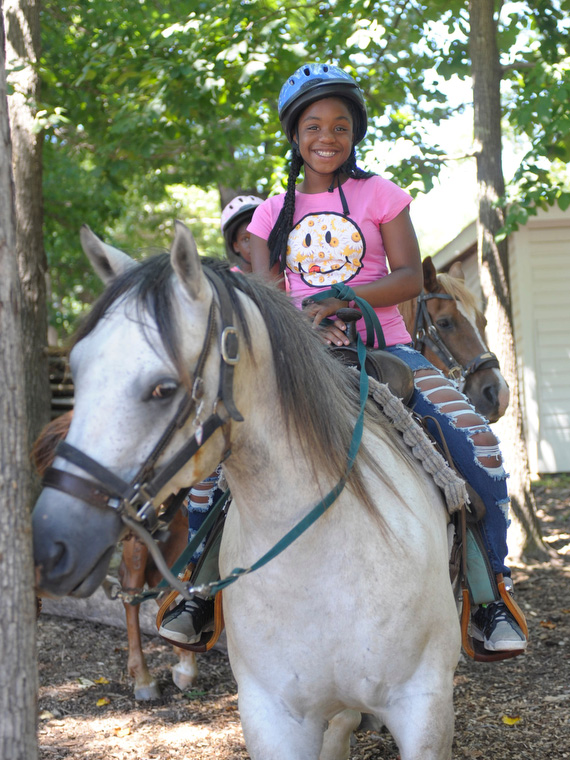 Grey Horse Ridden by Little Girl in Raleigh
